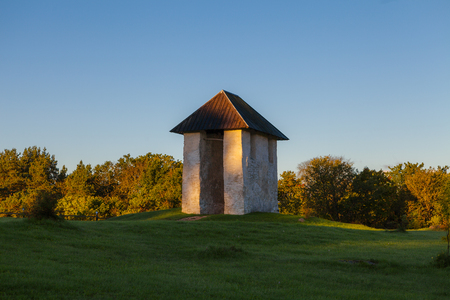 Bellfry of ancient Lutheran church in Kihelkonna, Saaremaa, Estonia. Early autumn sunny day. Stock Photo