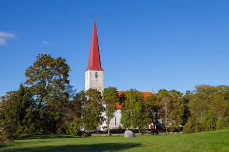 Ancient Lutheran church in Kihelkonna, Saaremaa, Estonia. Early autumn sunny day. Landscape view. Stock Photo