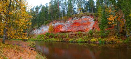 Sandstone rock along river Salaca, Latvia. Autumn time.