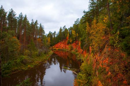 mirror: Sandstobe rock along river Salaca, Latvia. Autumn time. Stock Photo
