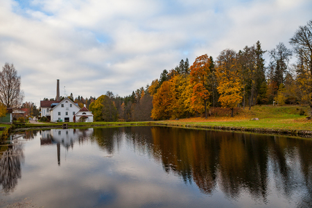 Palmse distillery and hotel reflection in water of pond, Estonia