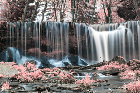 Infrared photography of waterfall. Color swapped process. Stock Photo