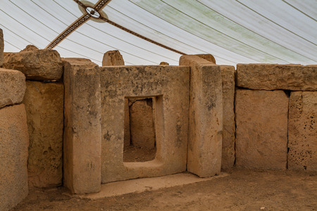 megaliths: MNAJDRA, MALTA - OCTOBER 16, 2016: Prehistoric temple, megalithic landmark of Malta island. Inside view.