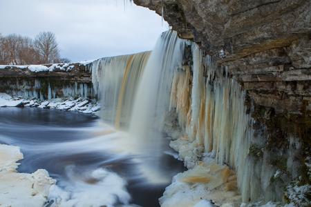 Frozen waterfall in winter time. Estonia.