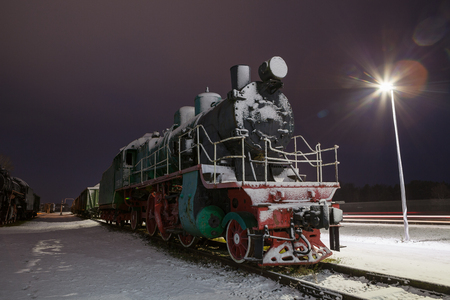 Old steam train at night. Vintage rural station. Winter time. Stock Photo