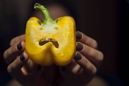 yellow Bell pepper in the cut with emotional angry look