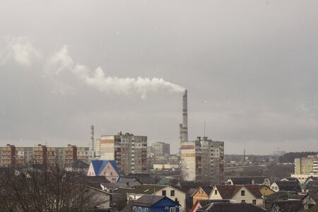 Industrial landscapes with plants and smoke pipes in the city. concept of environmental pollution and the planet