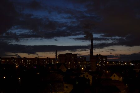Industrial landscapes with plants and smoke pipes in the city at night. concept of environmental pollution and the planet Imagens