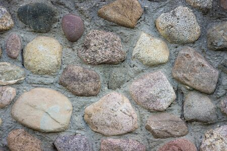 Texture of a stone wall. Stone wall as a background or texture, Part of a stone wall