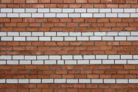 brick wall in white and red strip