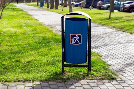 Minsk, Belarus - 28 november 2019: Blue garbage with logo along the road