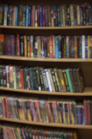 Abstract defocused background. Books in university library. Education theme
