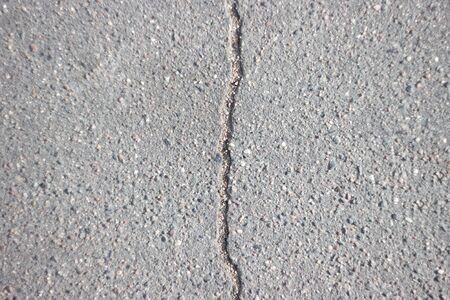 asphalt is divided into two parts with vertical separation