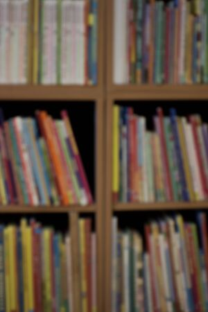 Defocus or blured shopping mall with abstract bookshelf bokeh light background in department store interior