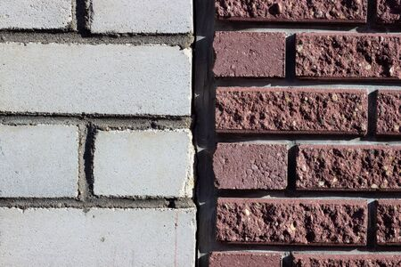 Brick laying on new technologies made up of red and white bricks.