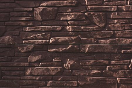 Pattern from lite brown decorative slate stone brick wall surface. panorama of brown stone, wall texture background.