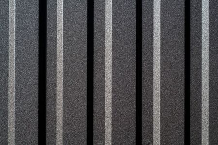 Abstract of monochrome metal blinds with a straight horizontal view, showing contrasting highlights and shadows