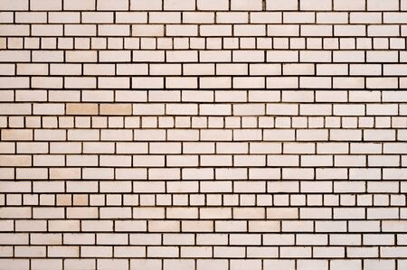 Clean smooth brick wall close-up. Texture of a brick wall. Stok Fotoğraf