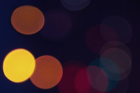 blurred colorful circle lights on the dark background, city light, abstract composition. Stok Fotoğraf
