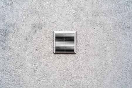Metal ventilation grille on white background.