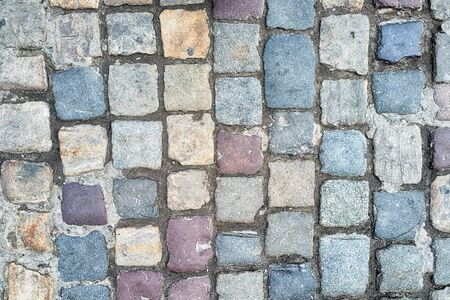 colorful paving slabs extending in the street.