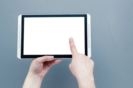 Woman hands holding contemporary generic tablet pc with blank screen