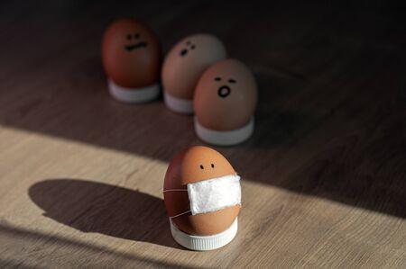 masked chicken easter egg. scared eggs avoid coronavirus infected. panic on face