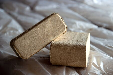 Alternative fuel, bio fuel. Eco briquette from sawdust perfect for stoves and fireplace