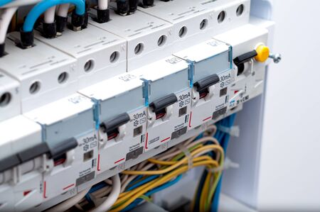 Voltage switchboard with circuit breakers. Electrical background close up Archivio Fotografico