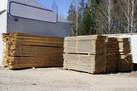 Edged boards in stock, ready for sale. Warehouse of construction materials. Stok Fotoğraf