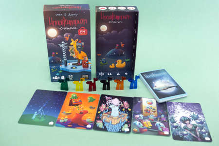 Card game Imaginarium with game items. Popular family associations board game. Minsk, Belarus - July 10, 2021 Editorial