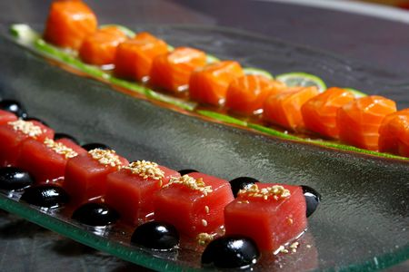 Allsorts from a fresh salmon and a tuna under sauces photo