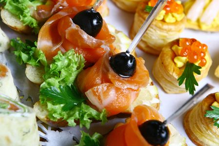 Allsorts from fish minisnack, an unleavened wheat cake with a smoked salmon, a canape with ����������� a salmon, a vol-au-vent with salmon caviar, ������� with shrimps Stock Photo - 4334330