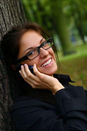 a beautiful young woman telephone talking  photo