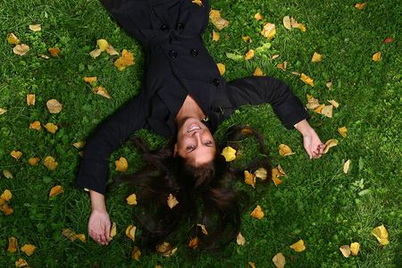 a beautiful young woman in autumn park photo