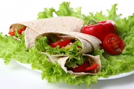 a fresh tortilla with peper and salad photo