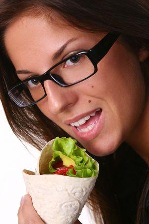 a beautyful woman eating fresh tortilla photo