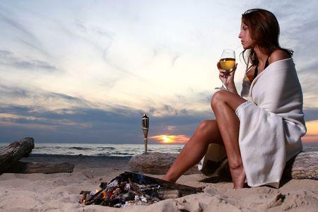 hot girl legs: beautiful young woman drinking wine Stock Photo