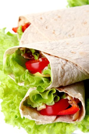 chicken fingers: fresh tortilla with vegetables and souce Stock Photo