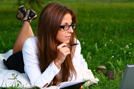 a beautiful young woman studing photo