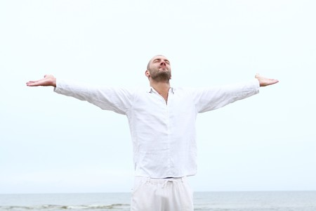 healthy body: attractive and happy man on the beach Stock Photo