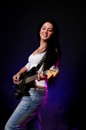 happy smiling teen playing guitar photo