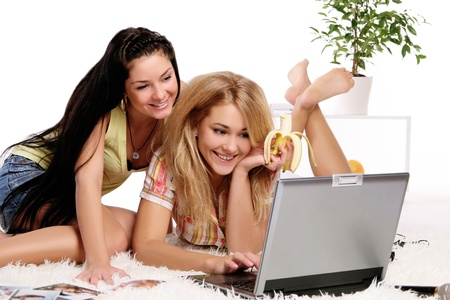 tenager: two young and beautiful girls at home