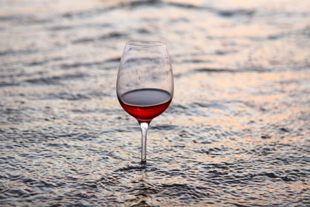 closed corks: wine glass in the sea at night