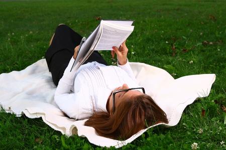a beautiful young woman studing photo