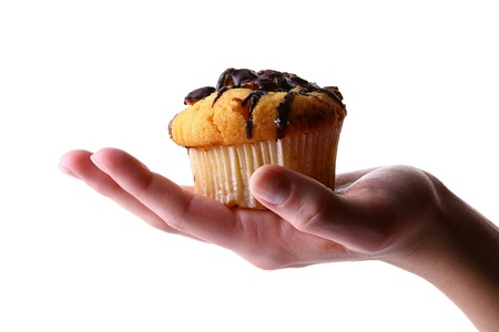 womans hand with fruitcake Stock Photo - 8312510