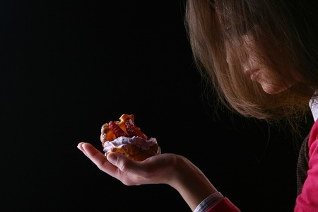womans hand with fruitcake Stock Photo - 8330873