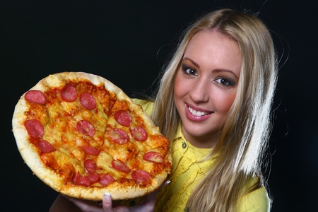 beautiful young woman eating pizza photo