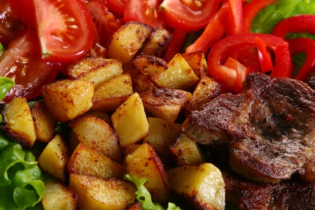 Meat plate with potatoe and souce photo