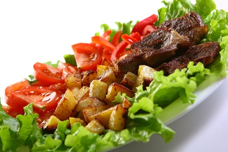 Meat plate with potatoe and souce Stock Photo - 8319774